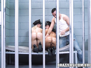 Jada Stevens and Annika Albrite fuck in the prison